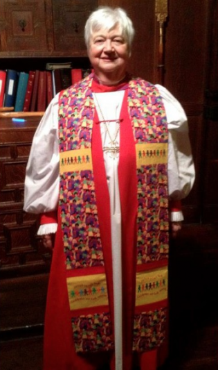 Photograph of clergy wearing Jesus Loves Clergy Stole