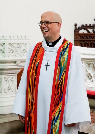 Photograph of clergy wearing the Red Jazzy Spirit Clergy Stole