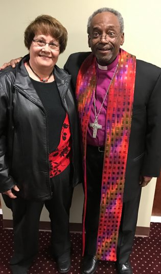 Photograph of Laurie Phillips with Bishop Curry wearing the Stole of Many Colors Clergy Stole