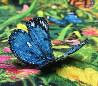 Closeup of embroidered blue butterfly