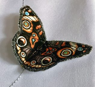 Photograph of an embroidered butterfly