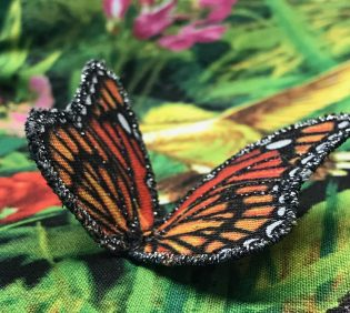 Closeup of embroidered monarch butterfly