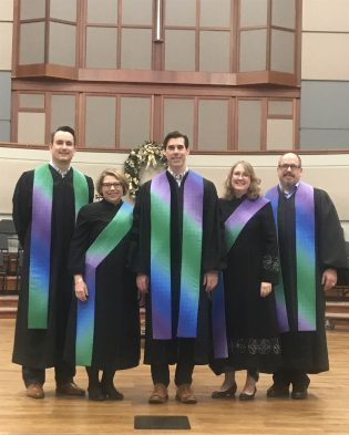 Men and women wearing the Rays of Light Clergy Stoles and Deacon Stoles