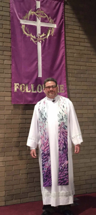 Photograph of clergy wearing the Tears of God Clergy Stole